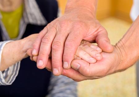 geriatrics: Caregiver giving helping hands for elderly woman