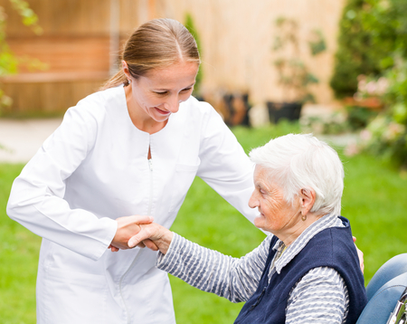 old carer: Photo of young carer helping the elderly woman