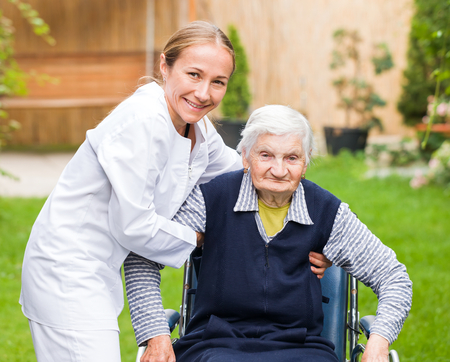 dementia: Photo of young carer helping the elderly woman