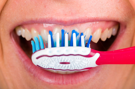 toothbrushing: Close up photo of tooth cleaning with toothbrush