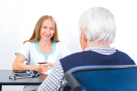 geriatrics: Photo of elderly women with the young doctor Stock Photo