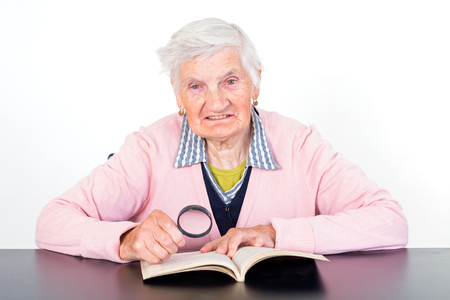 Photo of elderly woman reading a book Stock Photo