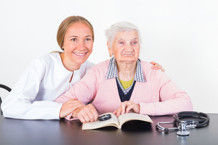 ageing: Photo of elderly women with the young doctor Stock Photo