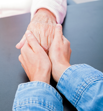 old carer: Young carer giving helping hands for elderly woman