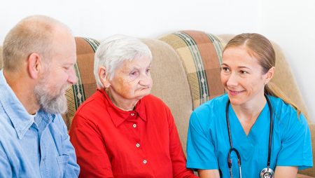 home health care: Elderly woman and her son at the doctor