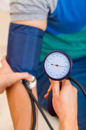 aide: Close up photo of blood pressure measurement