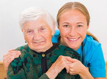 aide: Photo of elderly woman with the young doctor