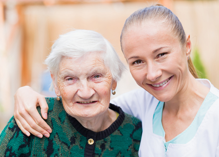ageing: Photo of elderly woman with her caregiver