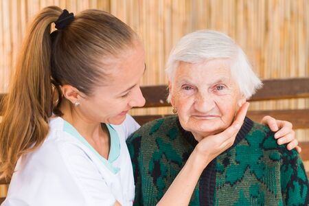 caresses: Photo of elderly woman with her caregiver