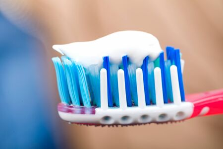 toothbrushing: Close up photo of toothbrush with toothpaste Stock Photo