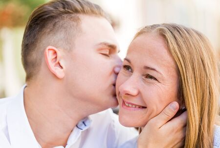 coquetry: Happy young couple in love in a romantic moment