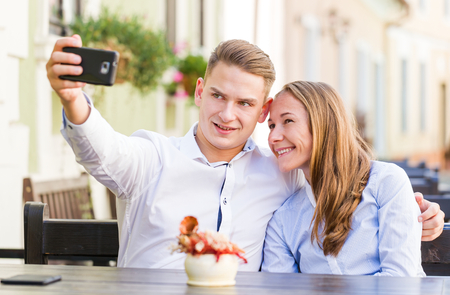 coquetry: Photo of happy young couple taking a selfie Stock Photo