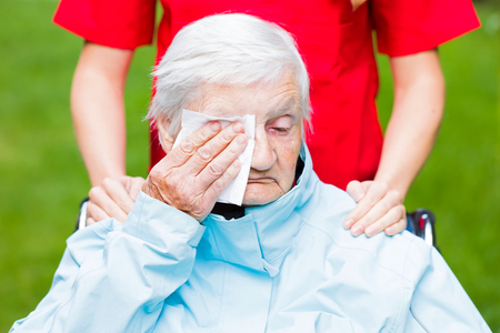 sad lady: Photo of sad elderly woman who is crying Stock Photo