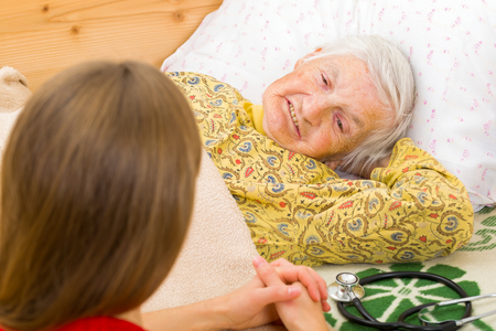 Photo of elderly woman with the caregiver