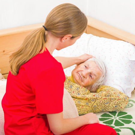 caresses: Photo of elderly woman with the caregiver