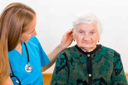 caresses: Photo of elderly woman with the young doctor