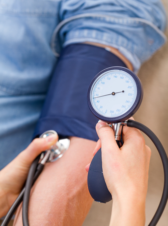 nursing aid: Close up photo of blood pressure measurement