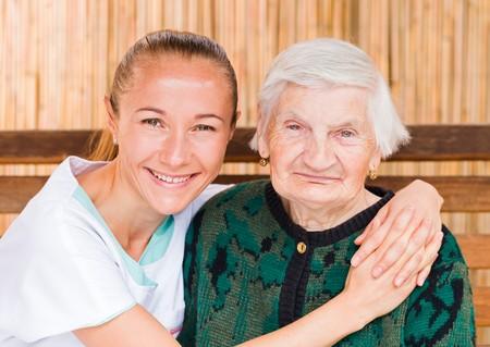 geriatrics: Photo of elderly woman with her caregiver