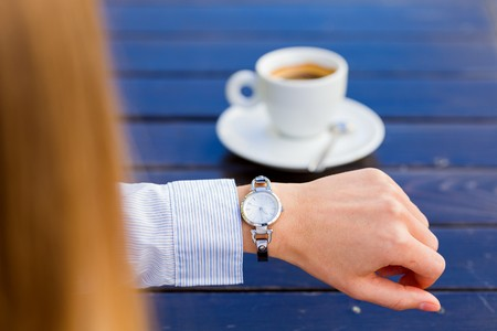 looking at watch: Photo of young woman waiting for someone