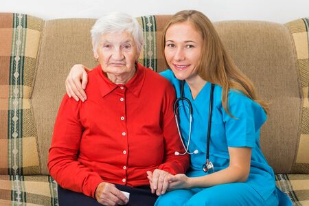 assistant: Photo of elderly woman with the young doctor