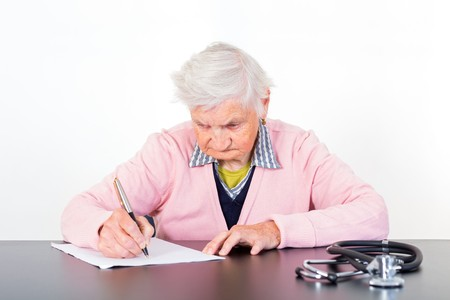 medical test: Photo of elderly woman completing a medical test Stock Photo