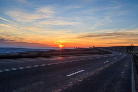 west country: Picturesque photo of country road and sunset