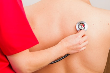 Close up photo of lung sounds auscultation with stethoscope