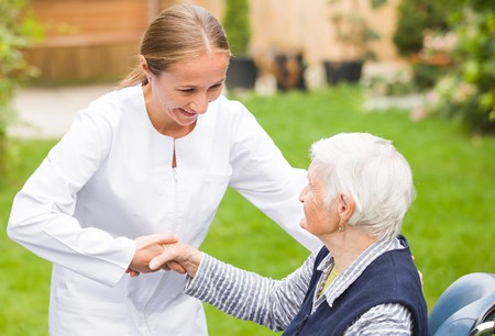 alzheimer: Photo of young carer helping the elderly woman