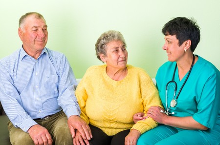 carers: Photo of happy elderly couple with the doctor