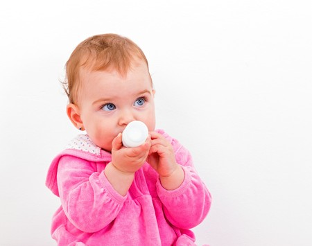 nibbles: Photo of an adorable baby girl nibbles the toy Stock Photo