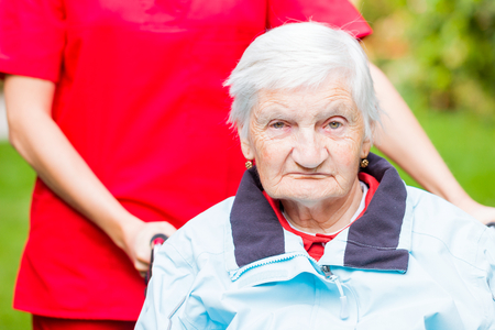 aide: Photo of elderly woman with the caregiver