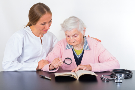 aide: Photo of elderly women with the young doctor Stock Photo