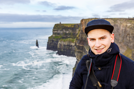 moher: Young charming tourist at Cliffs of Moher Stock Photo