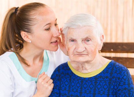 alzheimer: Photo of elderly woman with the young carer
