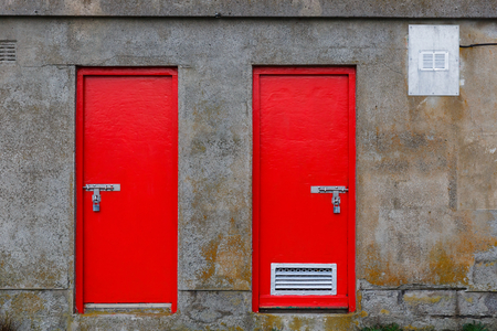 padlocked: Close up photo of two red warehouse door Stock Photo