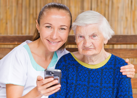 geriatrics: Photo of elderly woman with her caregiver