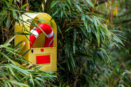 safer: Photo of a life buoy on the beach Stock Photo
