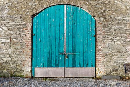 padlocked: Photo of a closed blue warehouse door Stock Photo