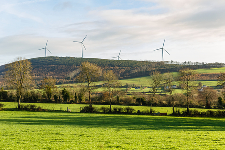 irish landscape: Beautiful irish landscape and windmills on the background Stock Photo