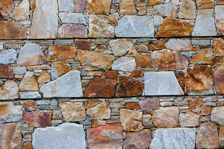 Close up photo of colorful stone wall Stock Photo