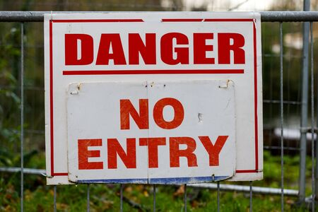 keep gate closed: Danger no entry warning board on fence