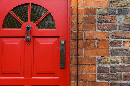 wooden doors: Detailed photo of a red front door and brick wall