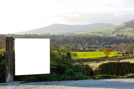 irish landscape: Beautiful irish landscape and an advertiser board on the farm fence