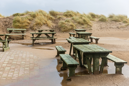 periodical: Photo of benches and sand dunes on the beach Stock Photo
