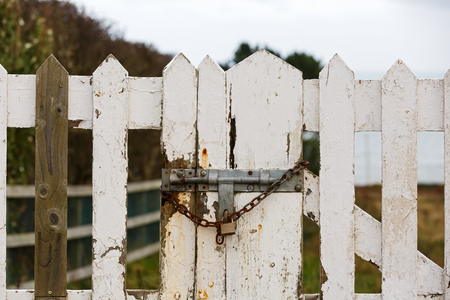 foreclosed: Close up photo of old locked gate