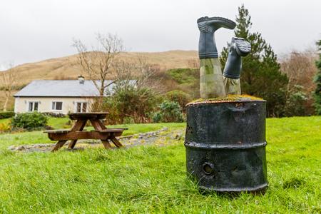 wellingtons: Decorative barrel and wellingtons in a rural garden