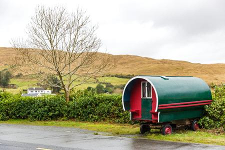 symbolic: Irish landscape and symbolic caravan on the roadside