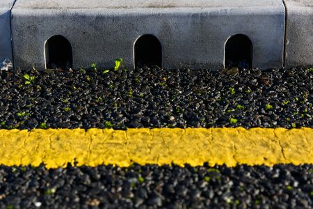 close to: Close up photo of rainwater drain on the road Stock Photo