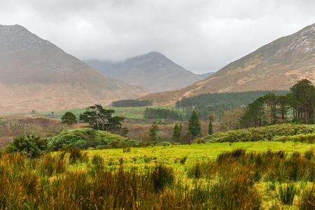 irish landscape: Picturesque irish landscape in Connemara mountains on a rainy day Stock Photo
