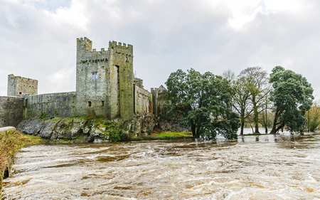 county tipperary: Photo of Cahir castle on the flooded Suir riverside